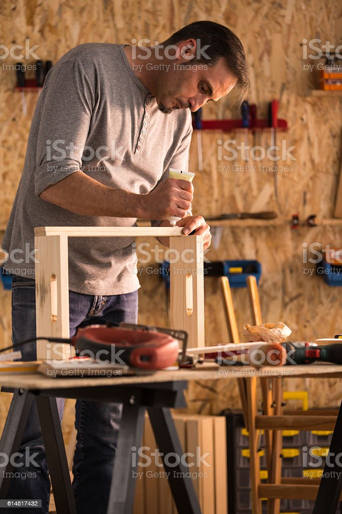 Carpenter making wooden product stock photo