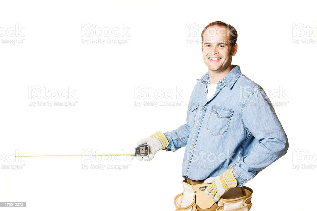 Carpenter Man Holding Tape Measure with Copy Space royalty-free stock photo