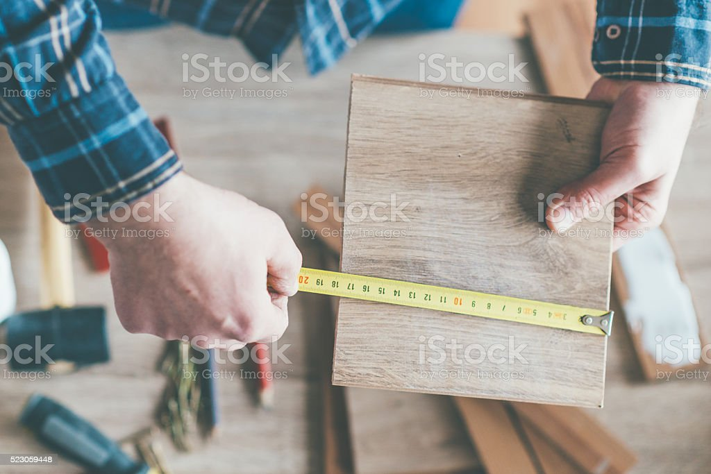 Carpenter measure stock photo