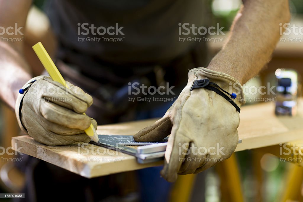 Carpenter Measuring A Wooden Plank. royalty-free stock photo