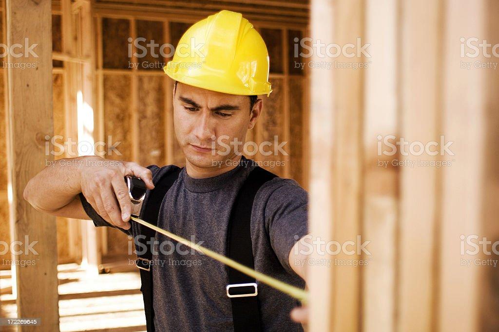 Carpenter Measuring royalty-free stock photo