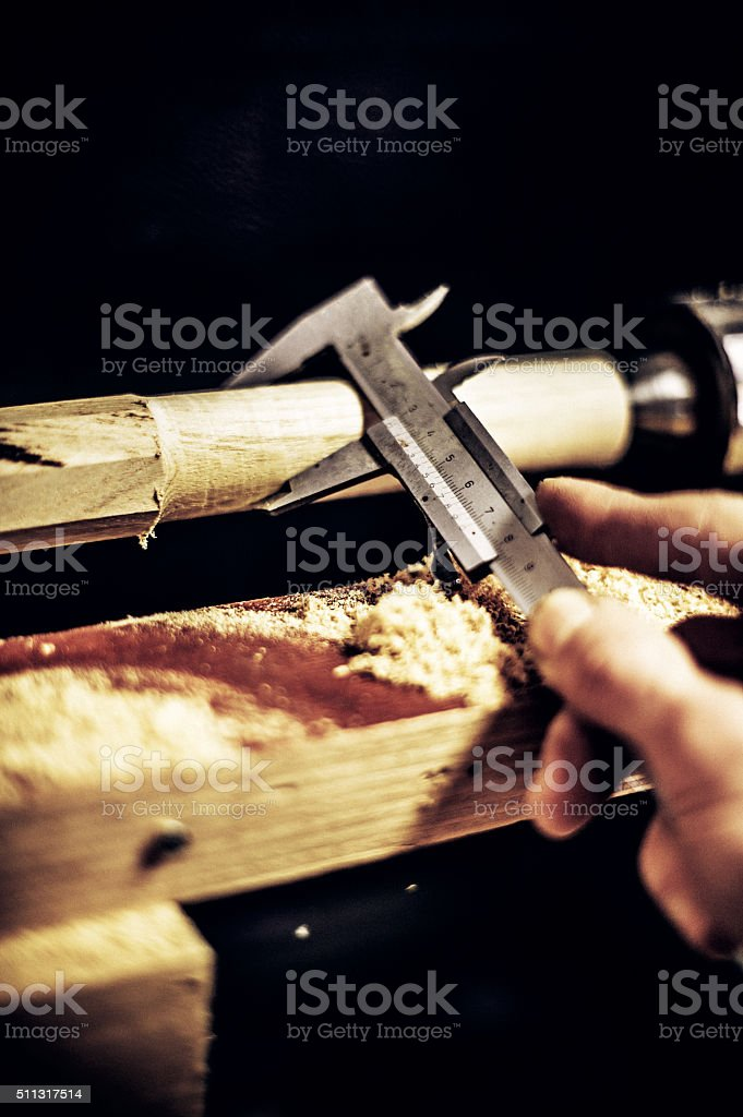 Carpenter Measuring Wood Thickness with Calipers, Copy Space stock photo