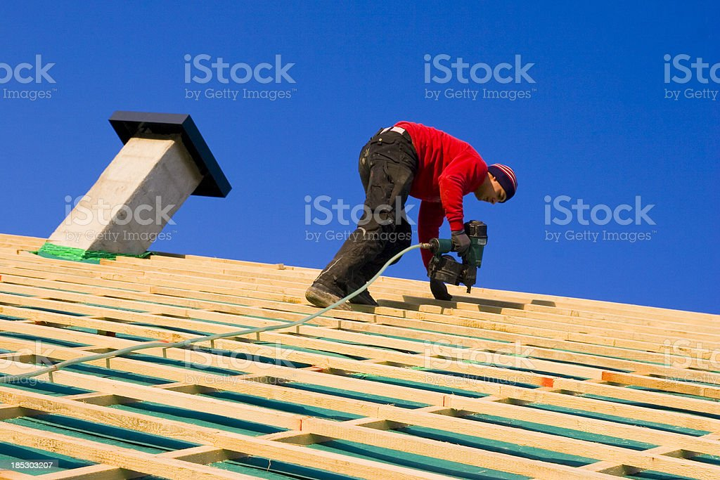 Carpenter on a Roof stock photo