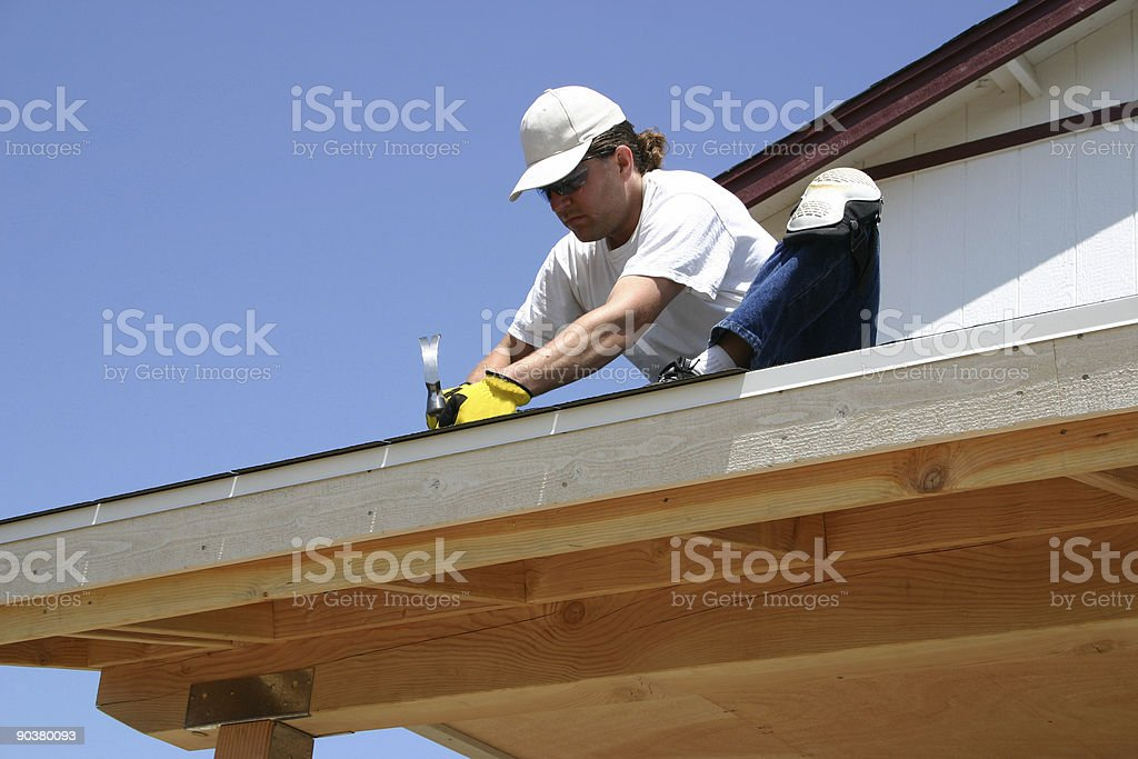 Carpenter on the roof royalty-free stock photo