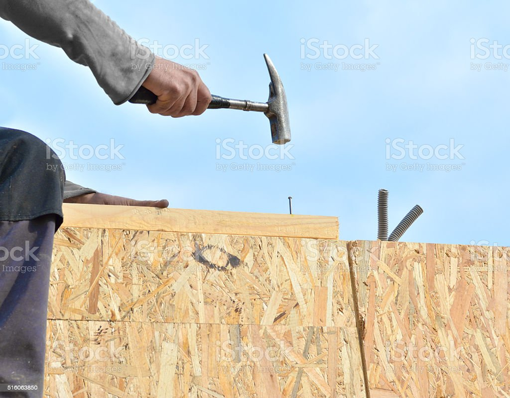 Carpenter or roofer checking roof construction stock photo