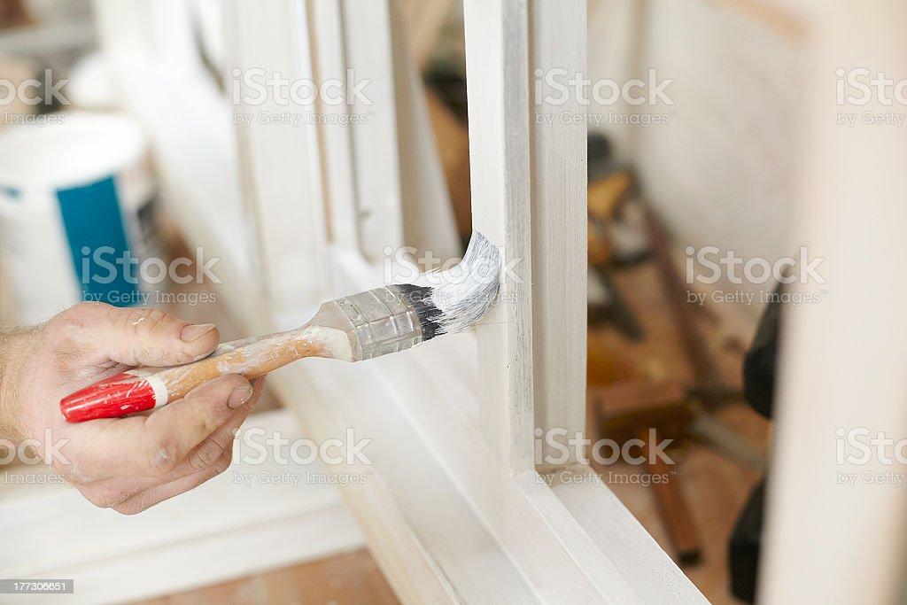 Carpenter painting Newly Made Windows stock photo