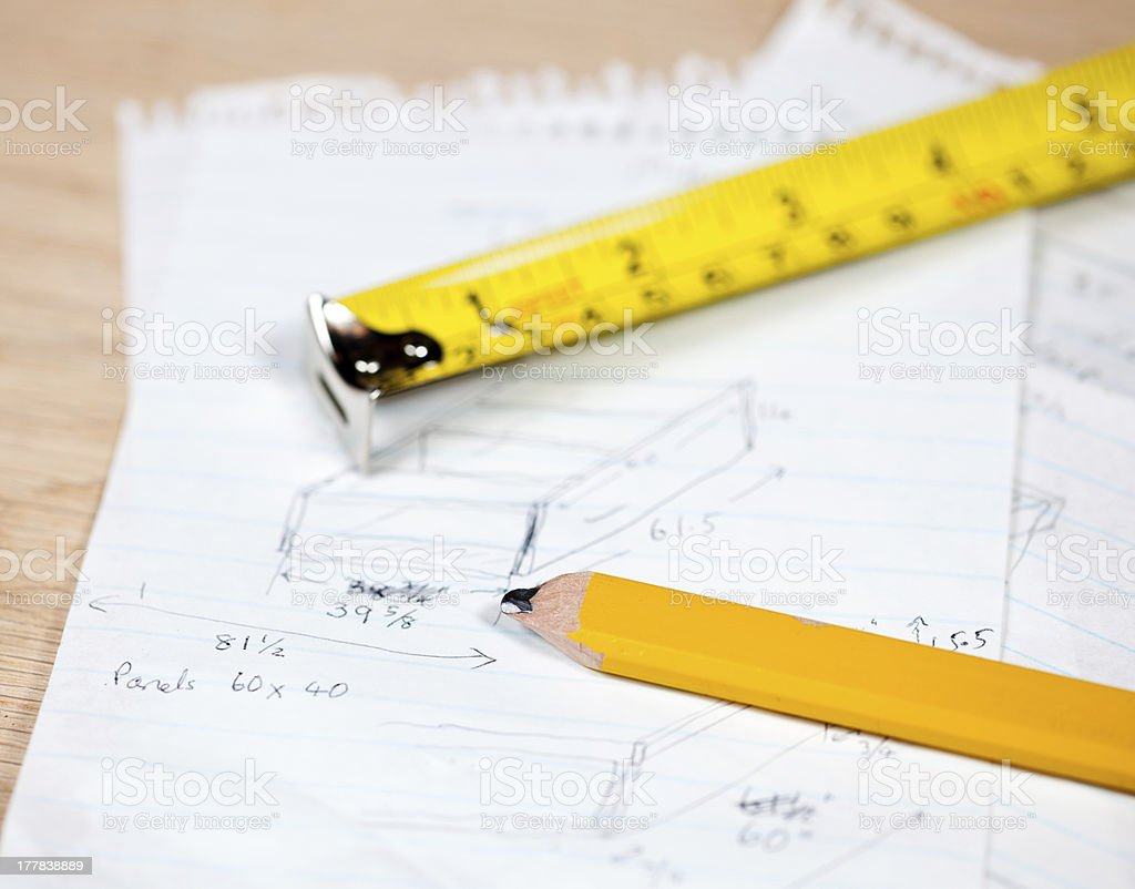 Carpenter pencil and rule on plans royalty-free stock photo