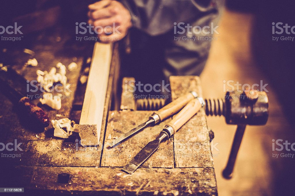 Carpenter Planing Wood, High Angle View stock photo