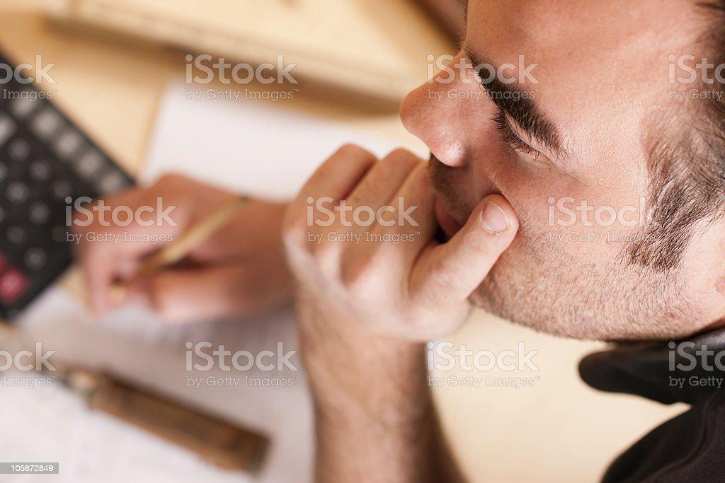 Carpenter planning his work royalty-free stock photo