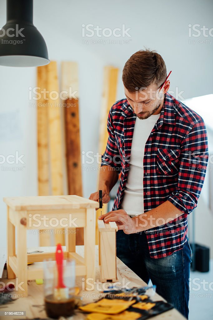 Carpenter repairing furniture stock photo