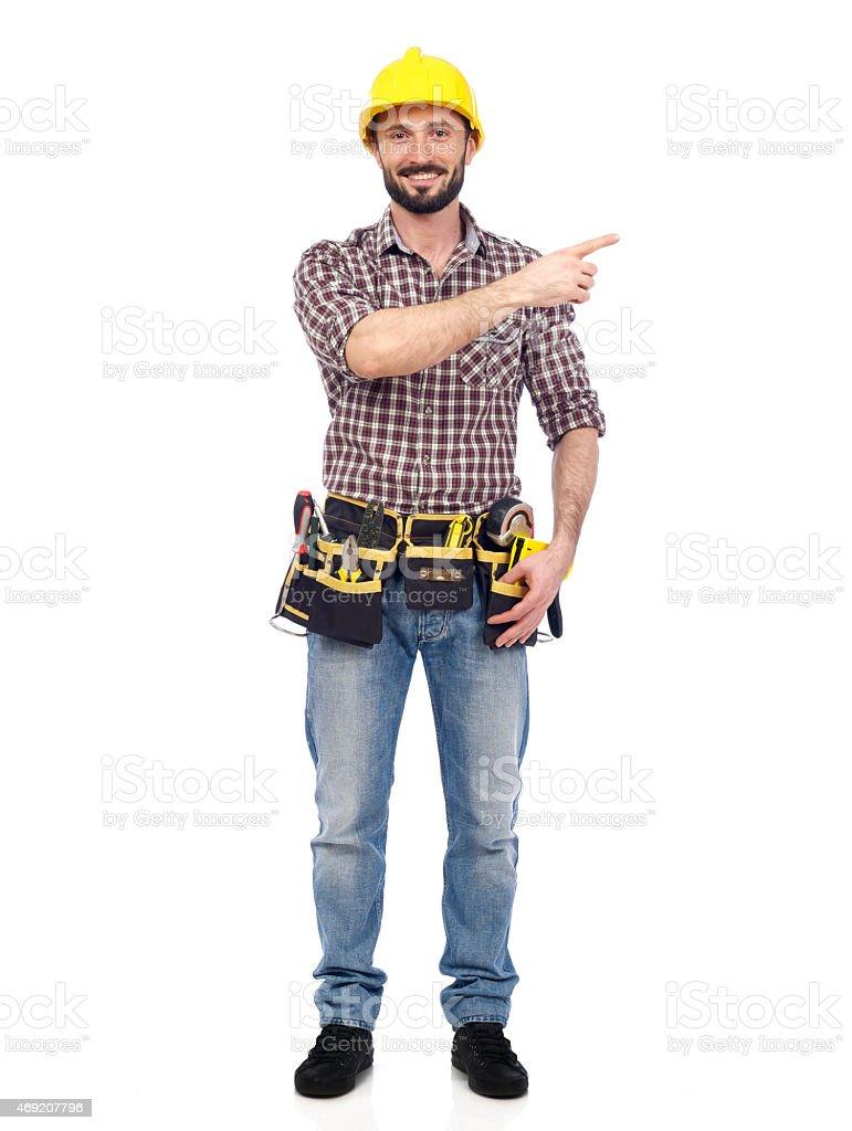 Carpenter showing stock photo