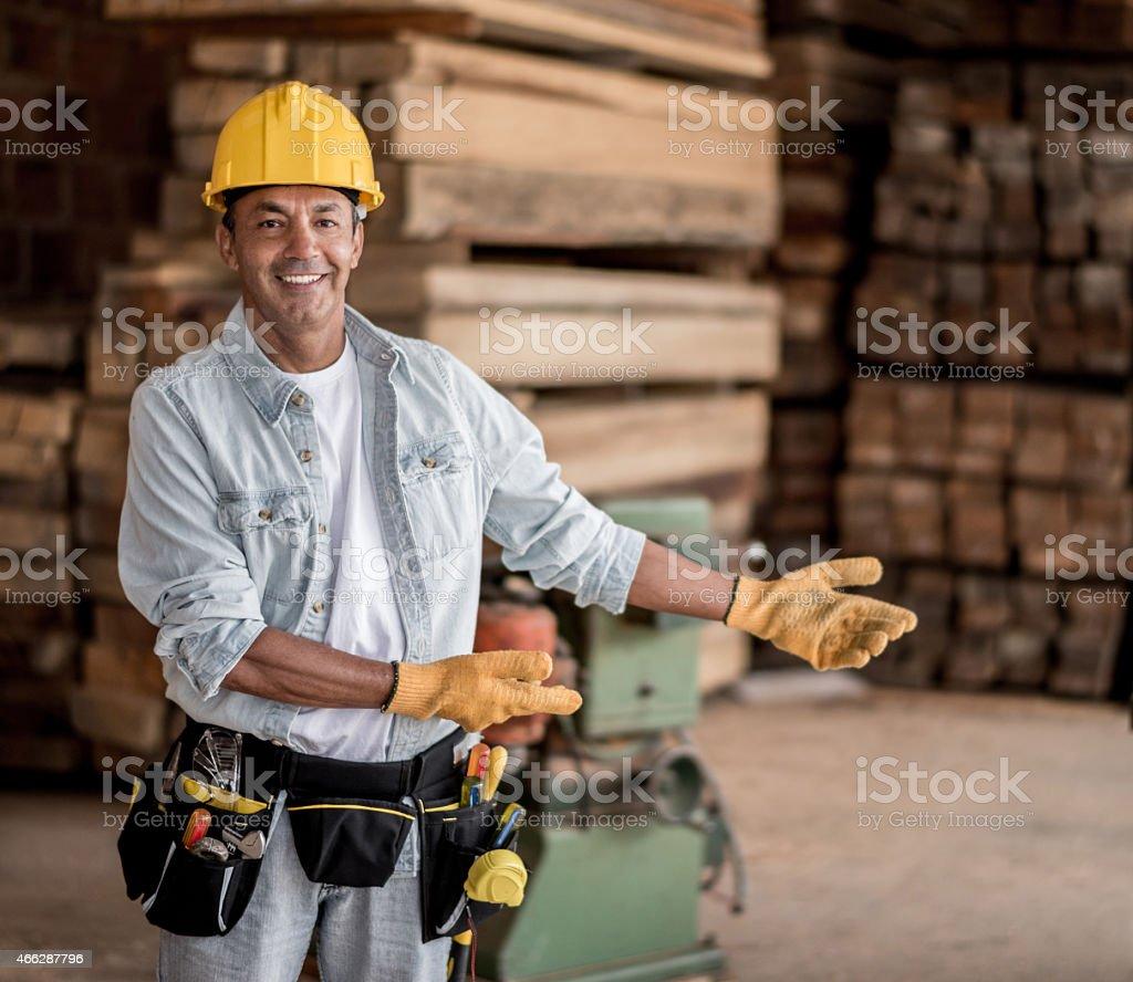 Carpenter showing piles of wood stock photo
