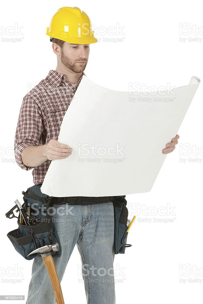 Carpenter standing with blueprint royalty-free stock photo