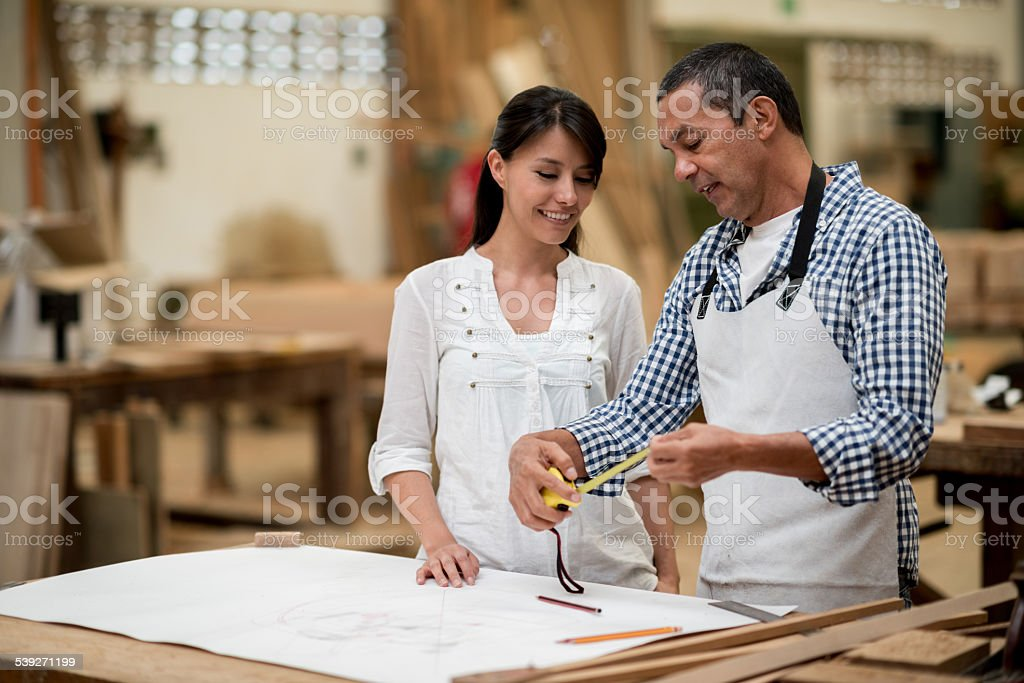 Carpenter talking to a client stock photo