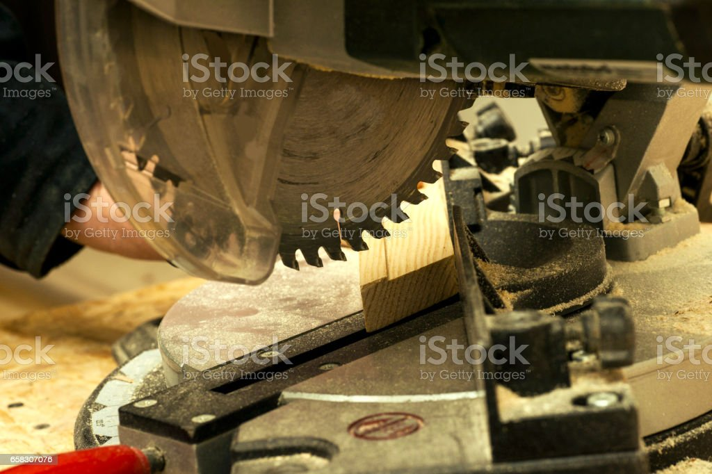 Carpenter tools on wooden table with sawdust. stock photo