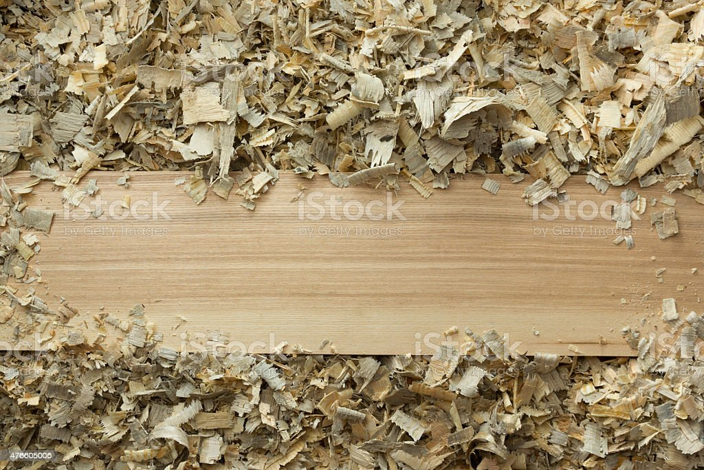 Carpenter tools on wooden table with sawdust. Workplace top view stock photo