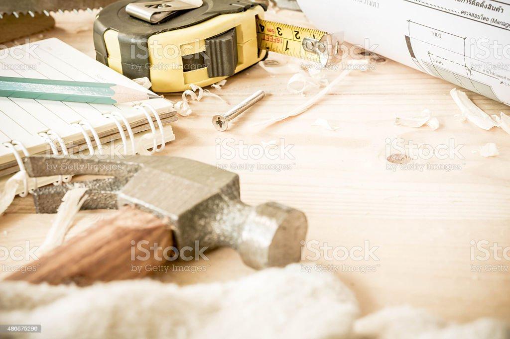 carpenter tools,hammer,meter,nails,shavings stock photo