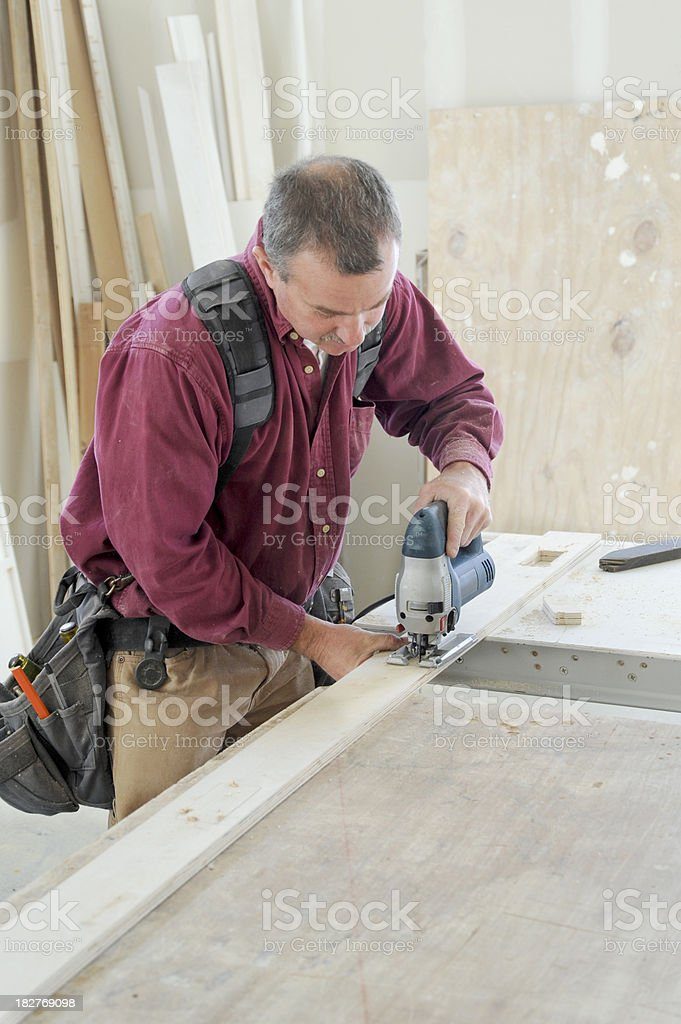 Carpenter using a jigsaw stock photo