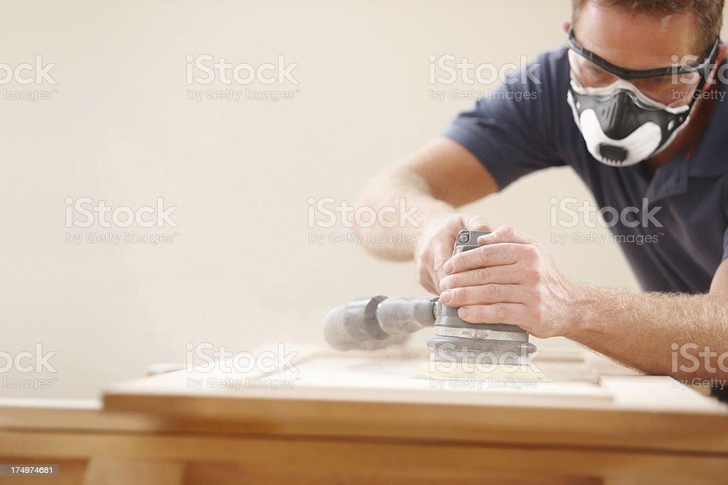 Carpenter using an electric sander stock photo