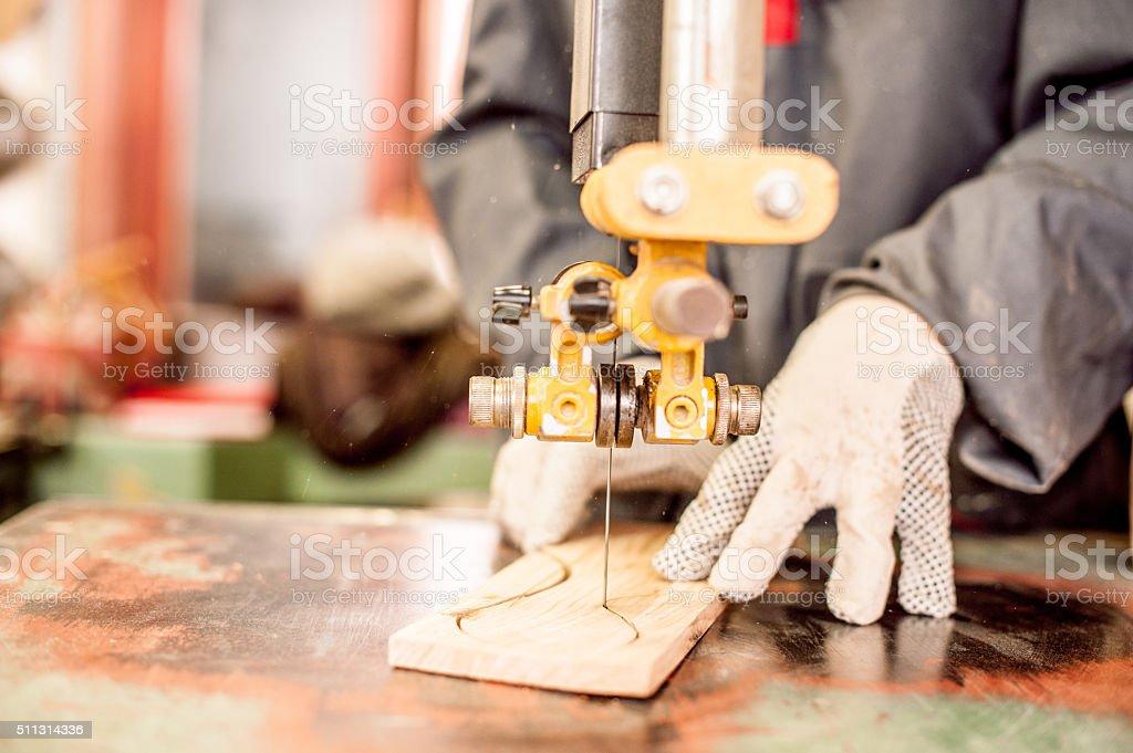 Carpenter Using Cutting Machine in Workshop, Close-up stock photo
