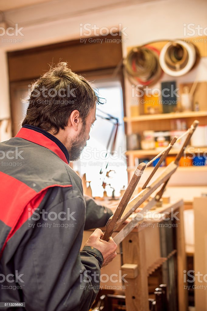 Carpenter Using Hand Wooden Frame Saw stock photo