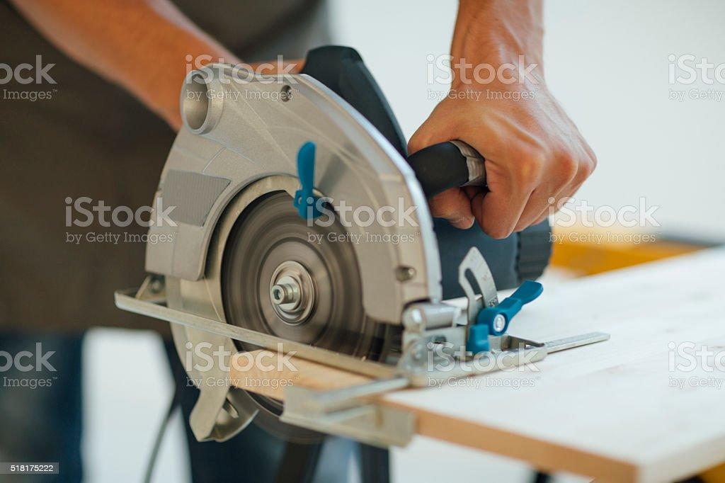 Carpenter Using His Circular Saw. stock photo