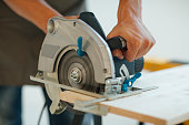 Carpenter Using His Circular Saw.