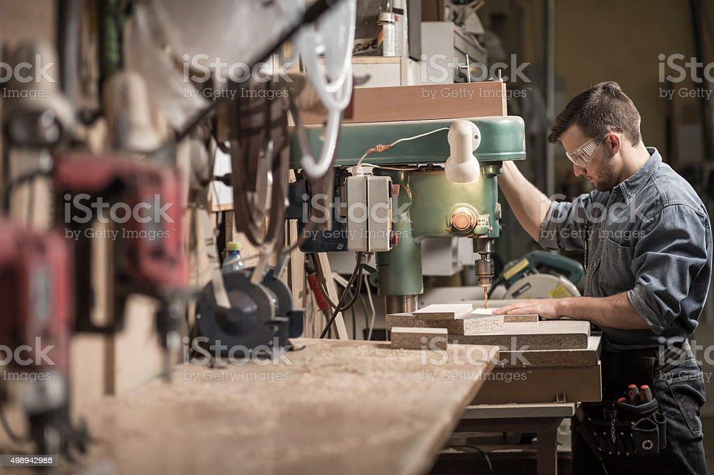 Carpenter using new technology stock photo