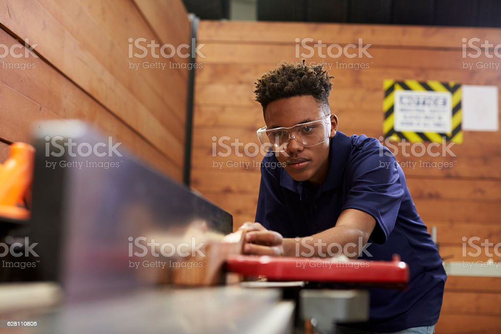 Carpenter Using Plane In Woodworking Woodshop stock photo