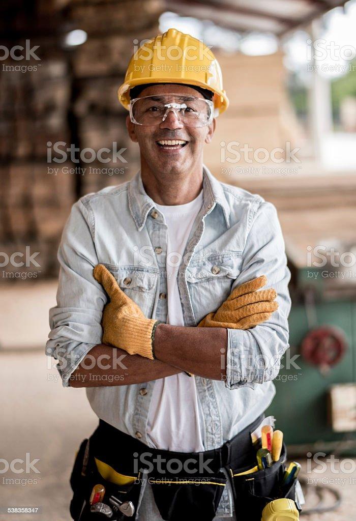 Carpenter wearing protective workwear stock photo
