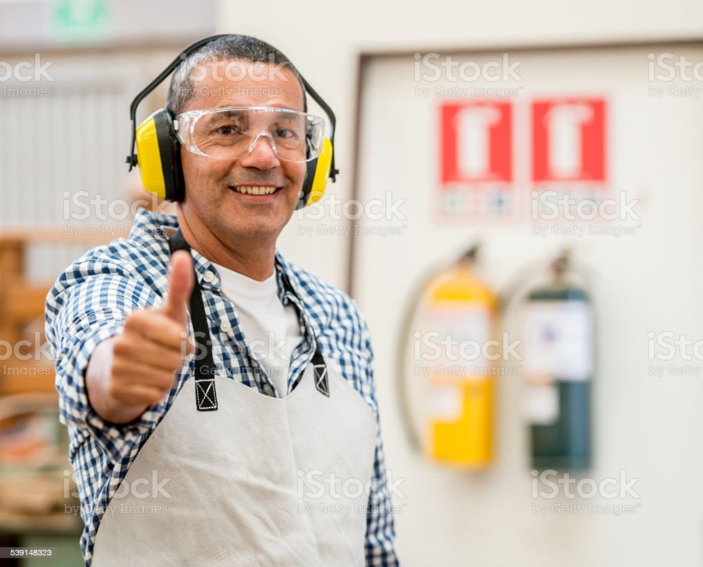 Carpenter wearing protective workwear stock photo
