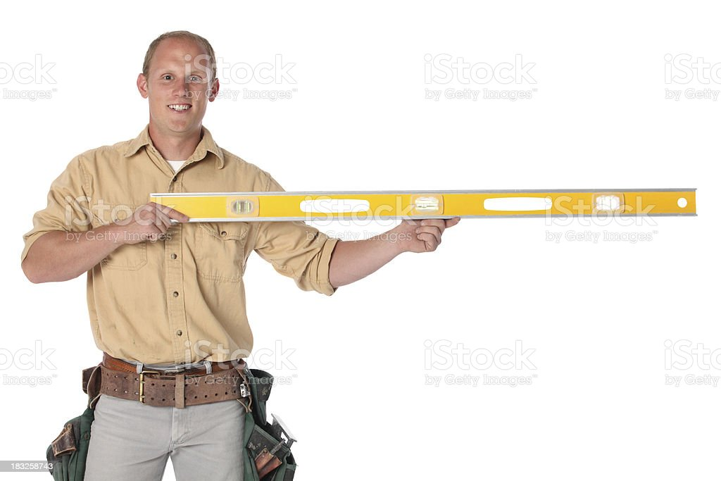 Carpenter with a spirit level royalty-free stock photo