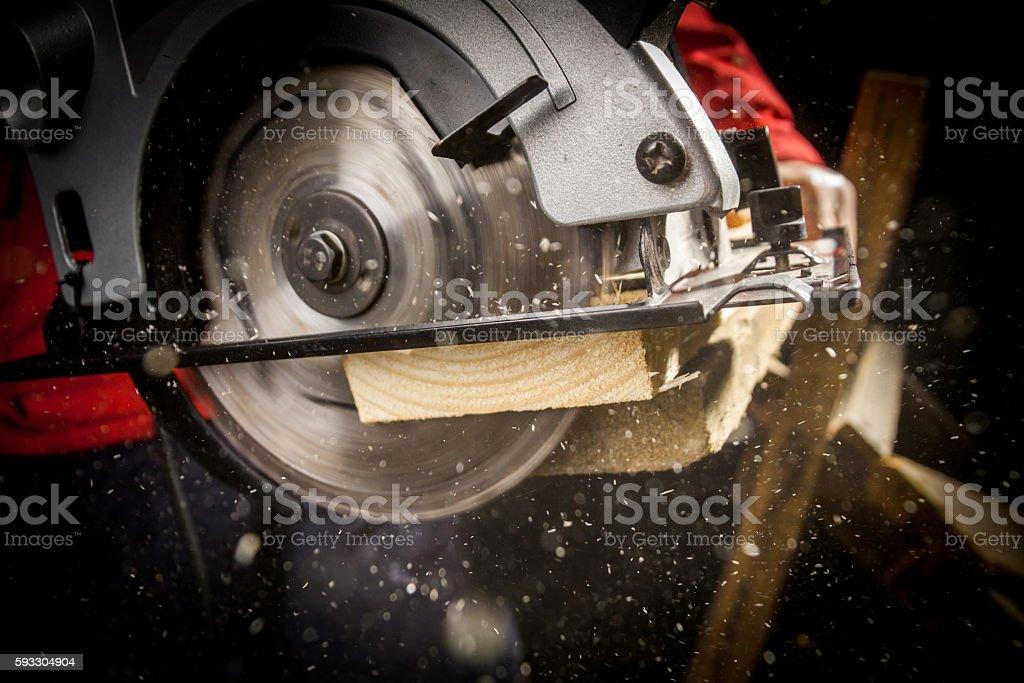 Carpenter with Circular Saw stock photo