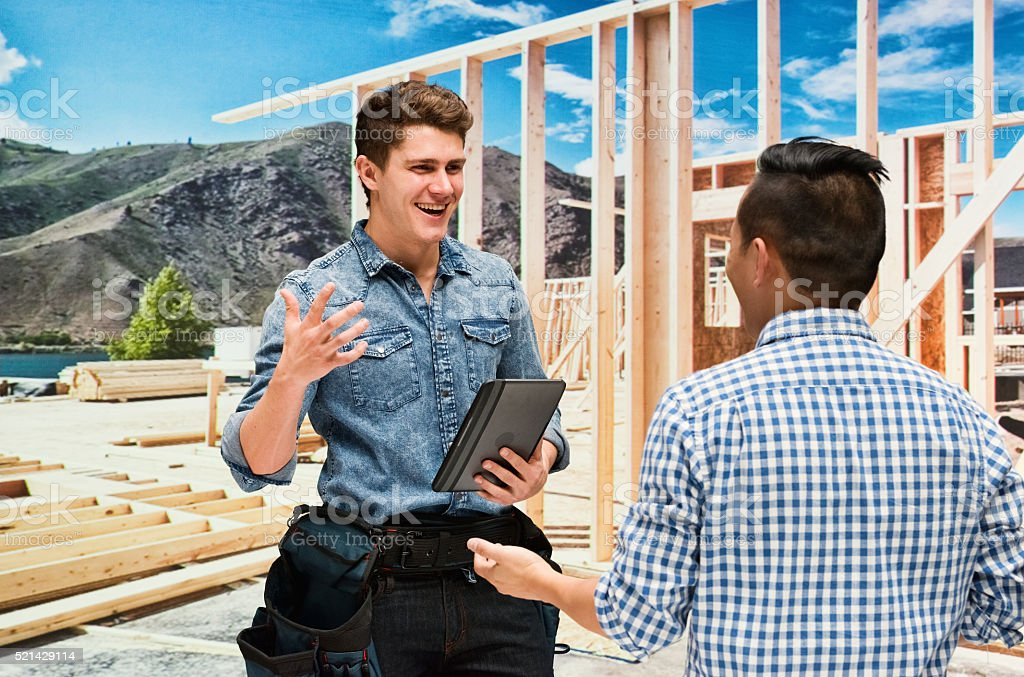 Carpenter with client stock photo
