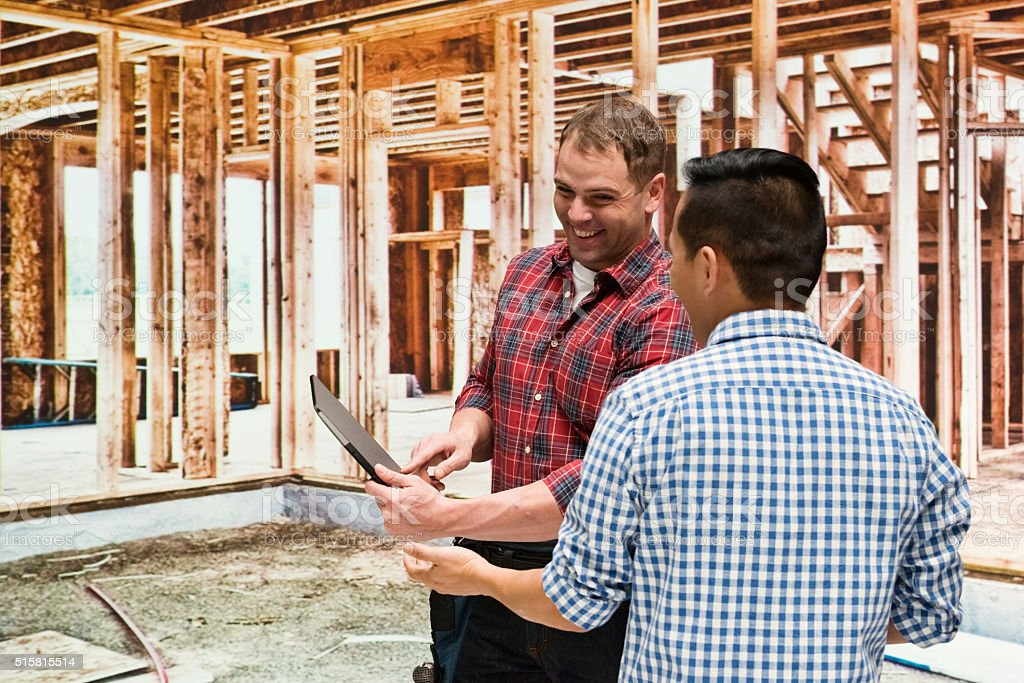 Carpenter with customer stock photo