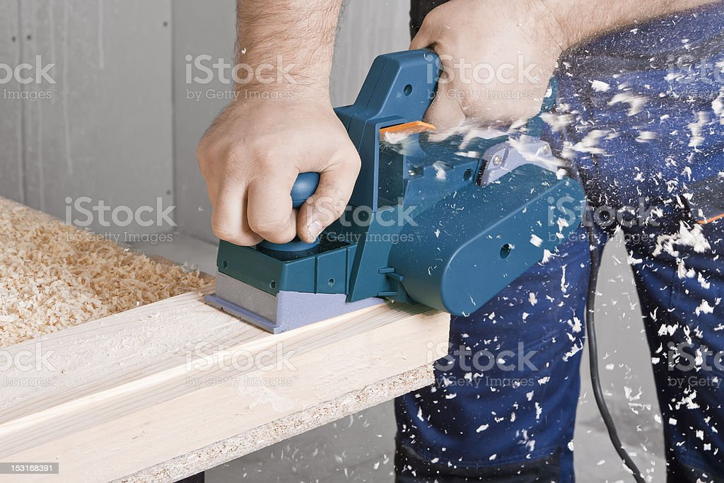 Carpenter with electric plane royalty-free stock photo