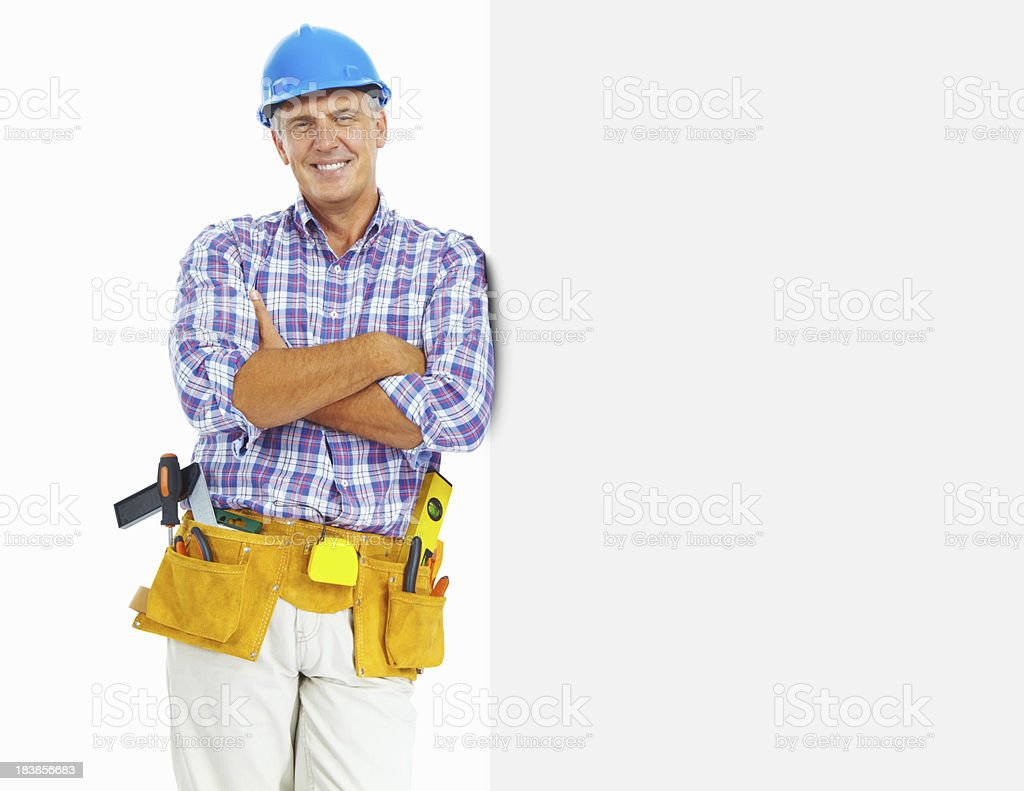 Carpenter with hardhat - copy space on white background royalty-free stock photo