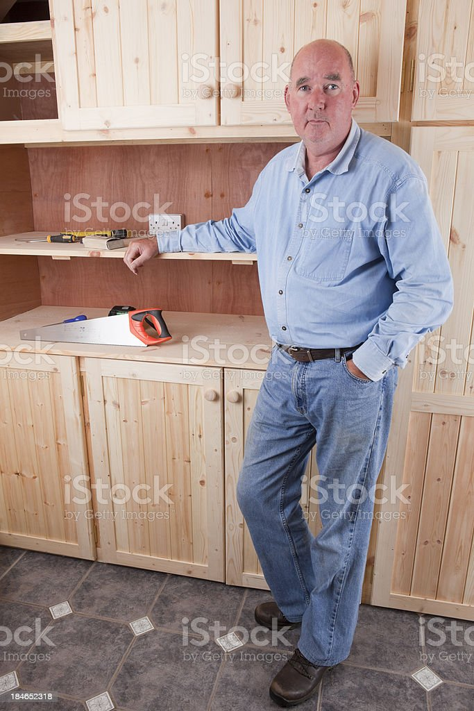 Carpenter With His New Cupboards royalty-free stock photo