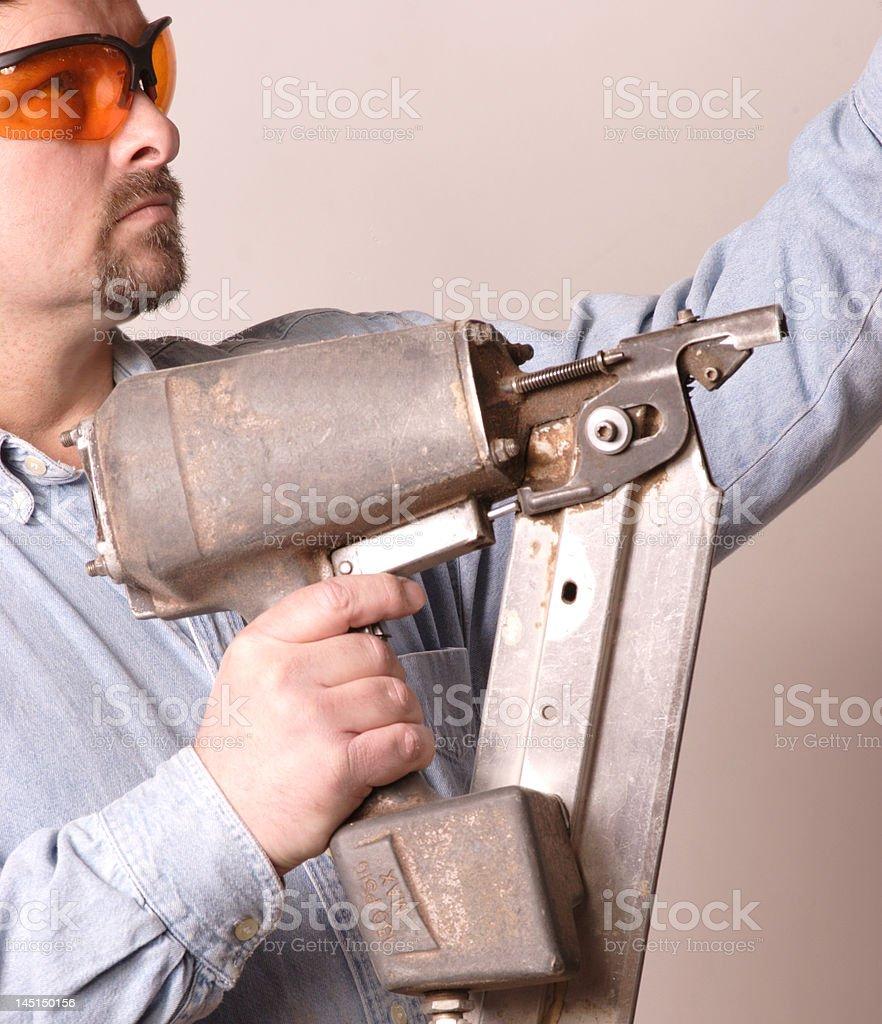 Carpenter with Nail Gun stock photo