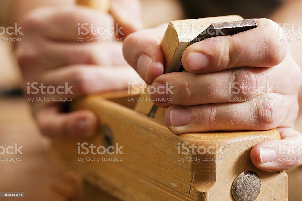 Carpenter with wood planer royalty-free stock photo