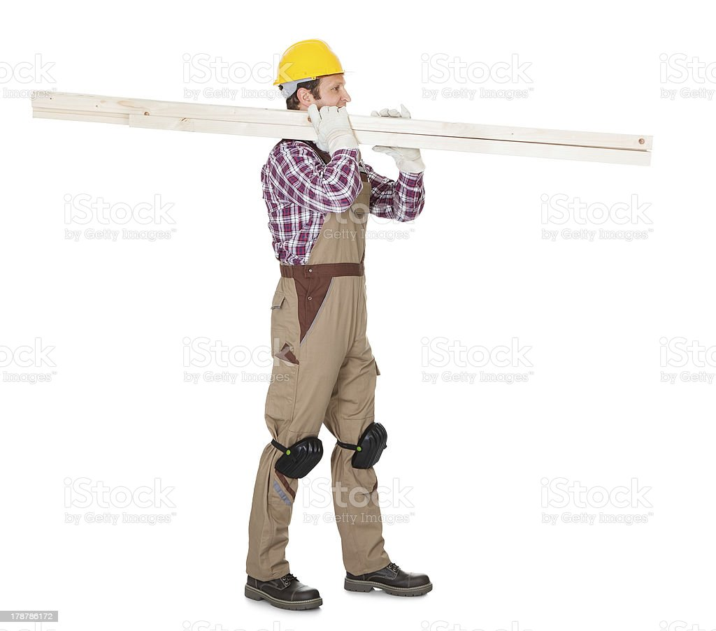 Carpenter with wooden planks royalty-free stock photo