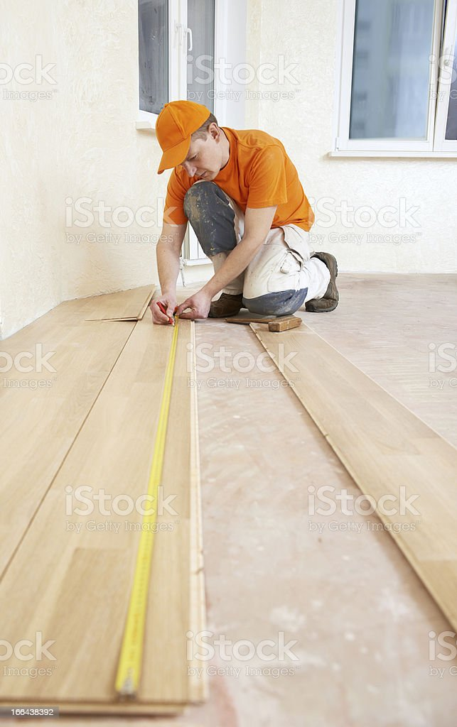 carpenter worker joining parket floor royalty-free stock photo
