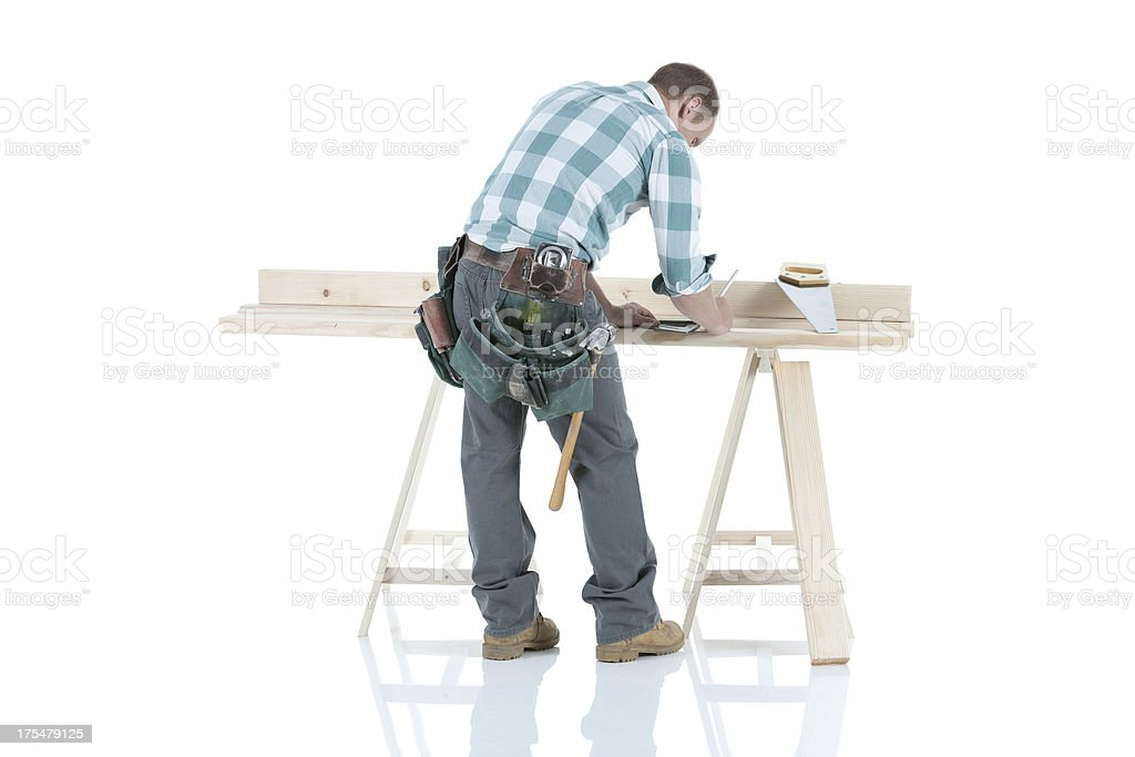 Carpenter working at a sawhorse royalty-free stock photo