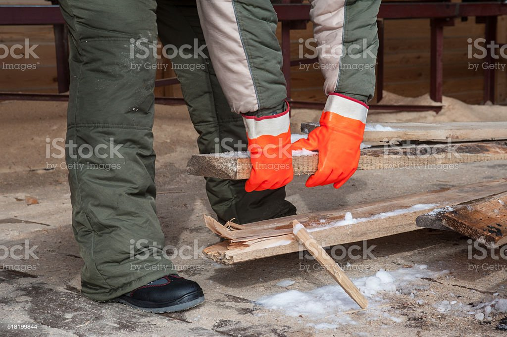 Carpenter working at sawmill stock photo