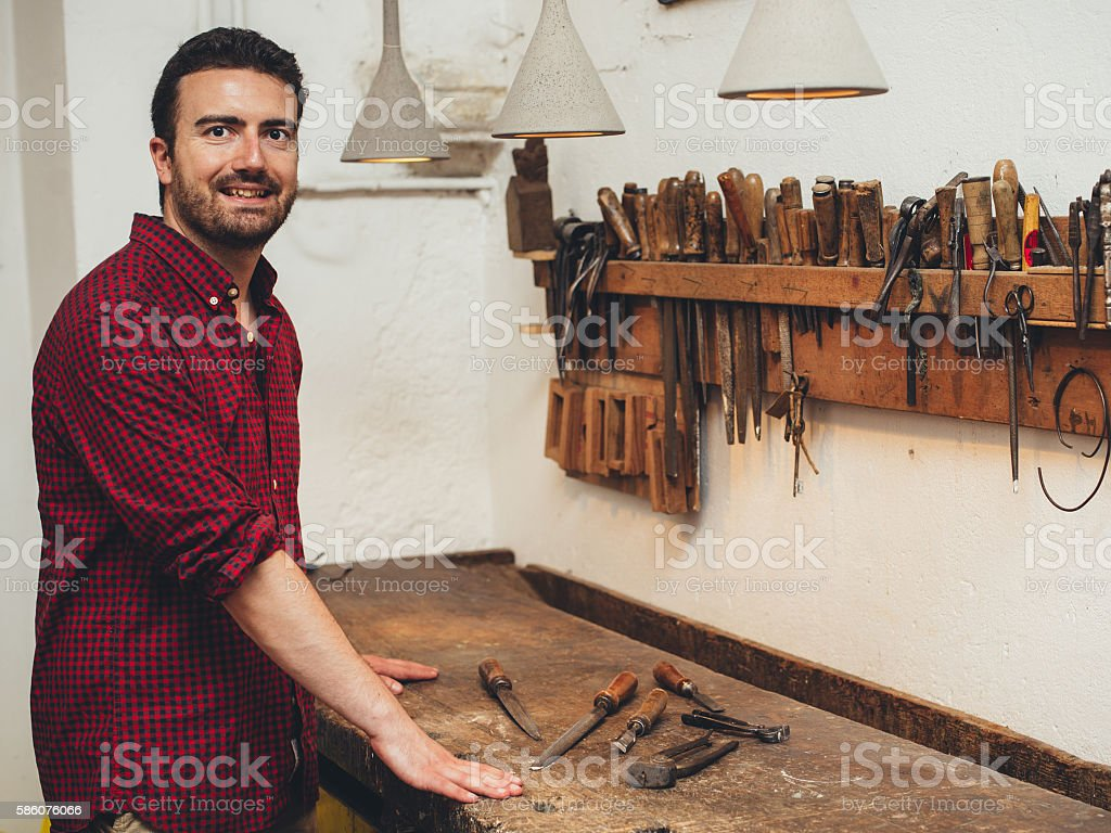 Carpenter working hard with tools in his carpentry stock photo