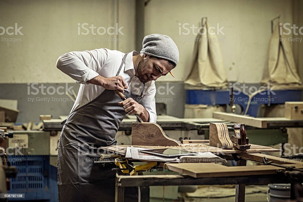 Carpenter working in his workshop stock photo