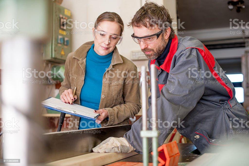 Carpenter Working in Workshop stock photo