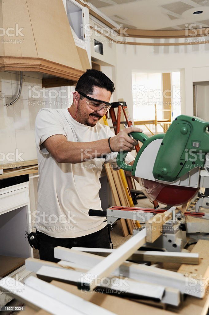 carpenter working on a custom kitchen royalty-free stock photo