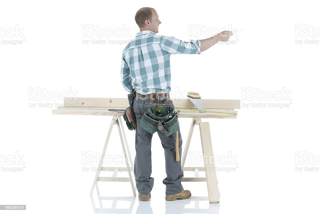 Carpenter working on a sawhorse royalty-free stock photo