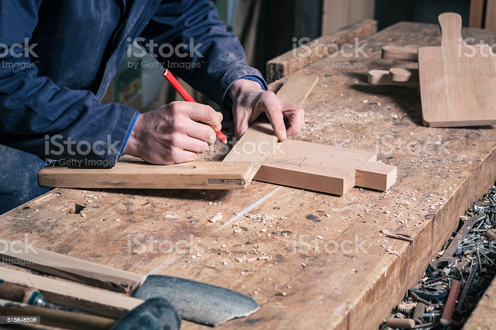 Carpenter Working on a Wooden Cutting Board stock photo